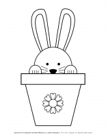 Easter Bunny peeking out of a flower pot